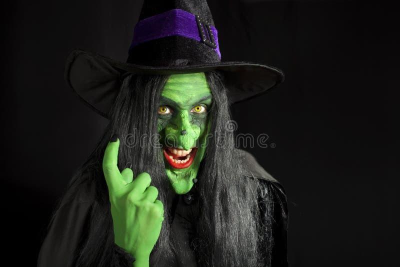 Bruxa que beckoning o para vir mais perto imagens de stock