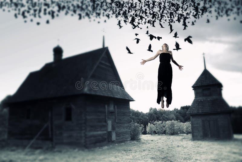 Bruxa que flutua no ar imagens de stock royalty free