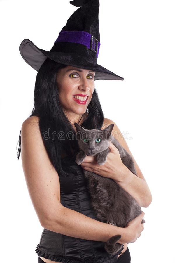 Bruxa 'sexy' e seu gato fotografia de stock royalty free