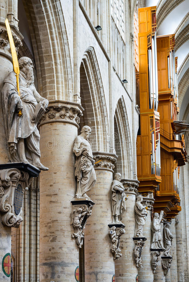 Bruxelles, Belgium. Statue of 12 apostles built 17th century detail in Gothic Style cathedral of Saint Michael in Brussels royalty free stock photography