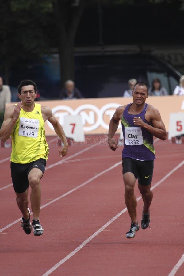 Bryan Clay and Oleksyi Kasyanov at IAAF decathlon. Bryan Clay from USA and Oleksyi Kasyanov from Ukraina in 100 metres discipline during the 4th TNT-Fortuna IAAF stock photo