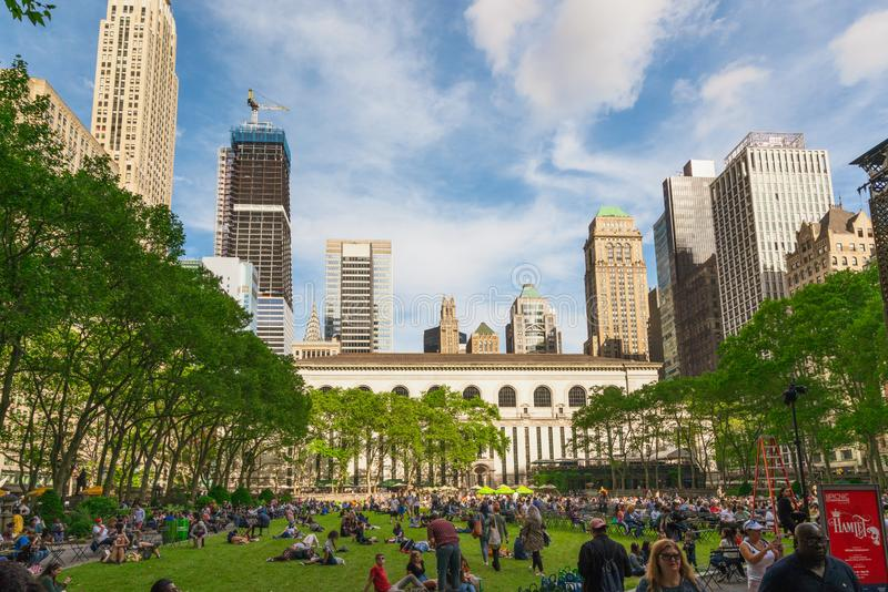 Bryant Park, Also Known as Manhattan`s Town Square, NYC. Surrounded by iconic skyscrapers, Bryant Park is visited by more than 12 million people each year. New stock photography