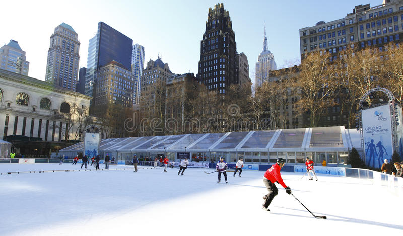 Bryant Park Ice hockey. On a Sunday morning, New York City with the Empire State building in the skyline. February 2012 royalty free stock image