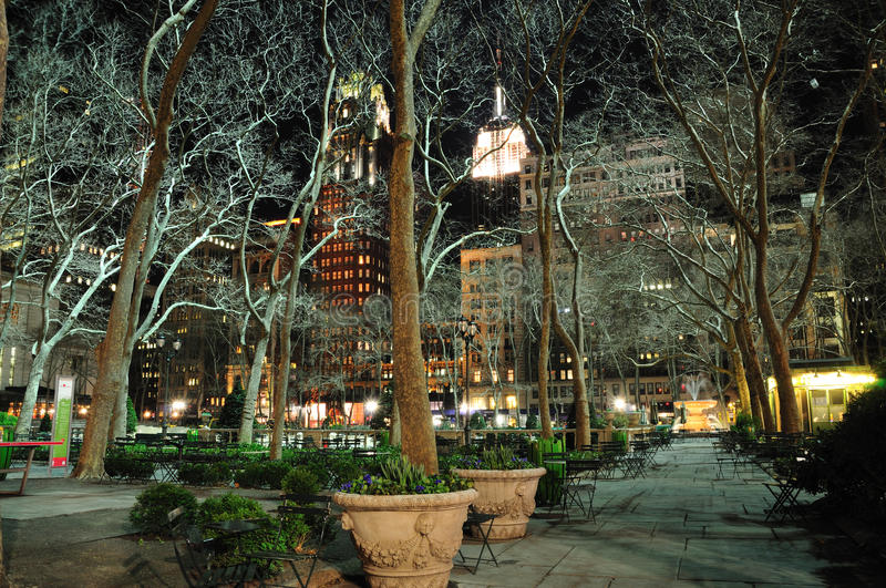 Bryant Park New York. City at night with Empire State Building stock photography
