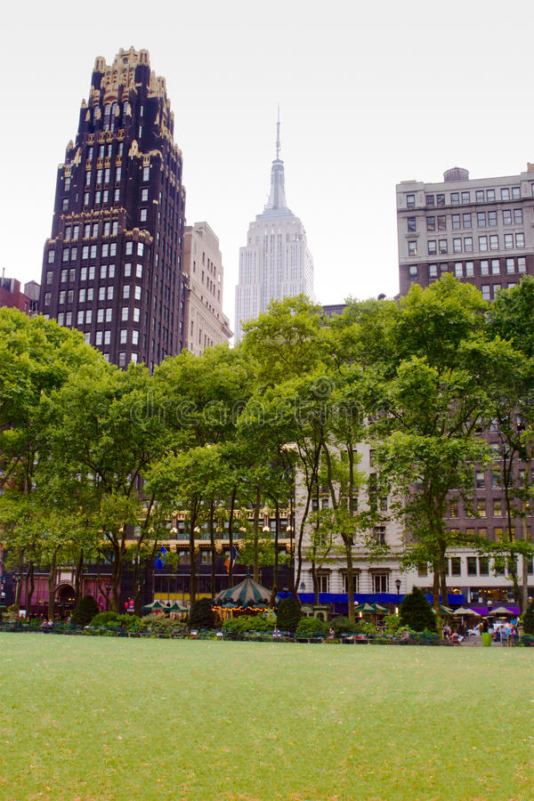 Bryant Park, New York. View of trees and buildings from Bryant Park located in midtown Manhattan, New York stock photo