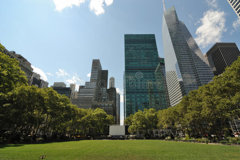 Bryant Park New York City. Bryant Park surrounded by skyscrapers in New York City stock images
