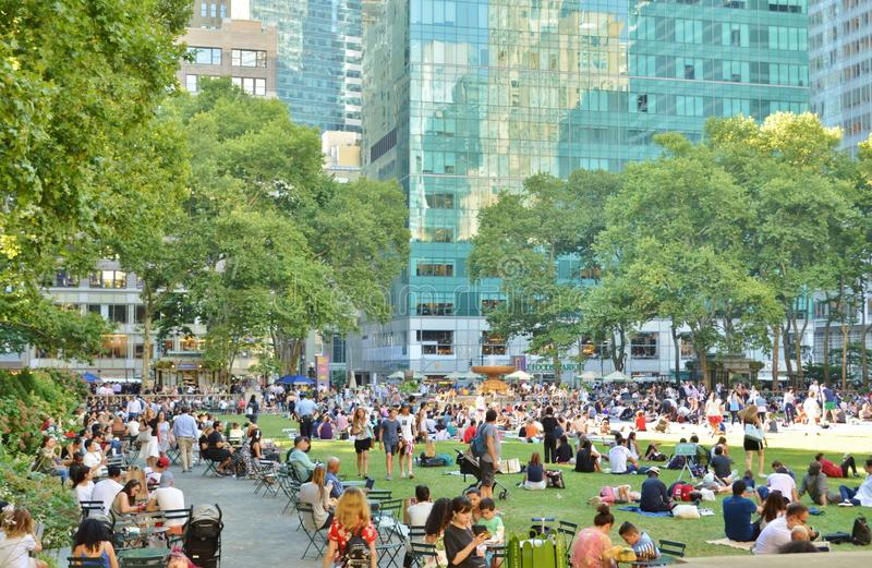 Bryant Park New York City People Relaxing Crowded Summer Time Tourist Attraction royalty free stock photo