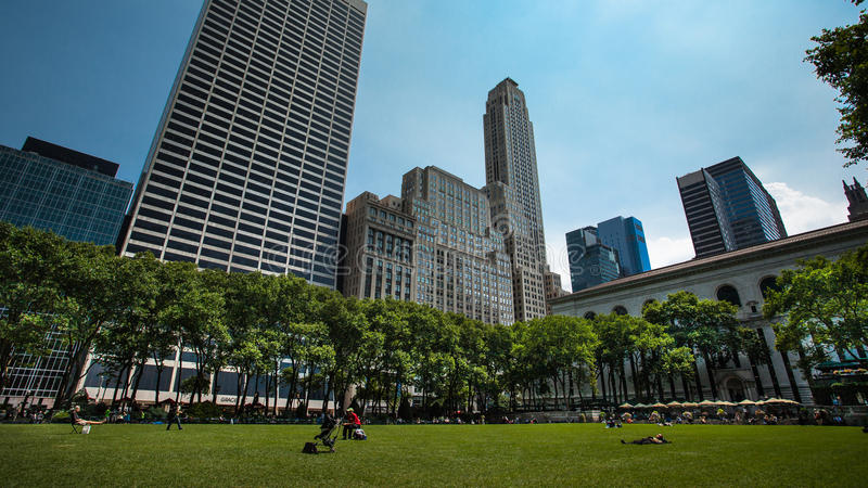 Bryant Park and The New York public Library. Beautiful view of the tall skyscrapers in midtown manhattan from Bryant park stock photography