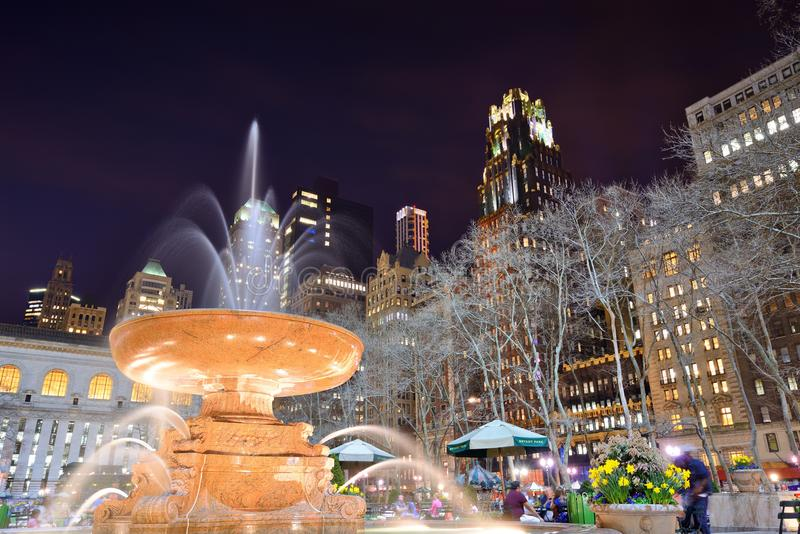 Bryant Park. People enjoy Bryant Park at night April 9, 2013 in New York, NY. The 9.6 acre park was first designated as public space in 1686 stock photo