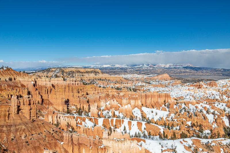 Bryce Canyon Winter View. Looking out over Bryce Canyon on a sunny winters day, with snow on the rock formations stock photos