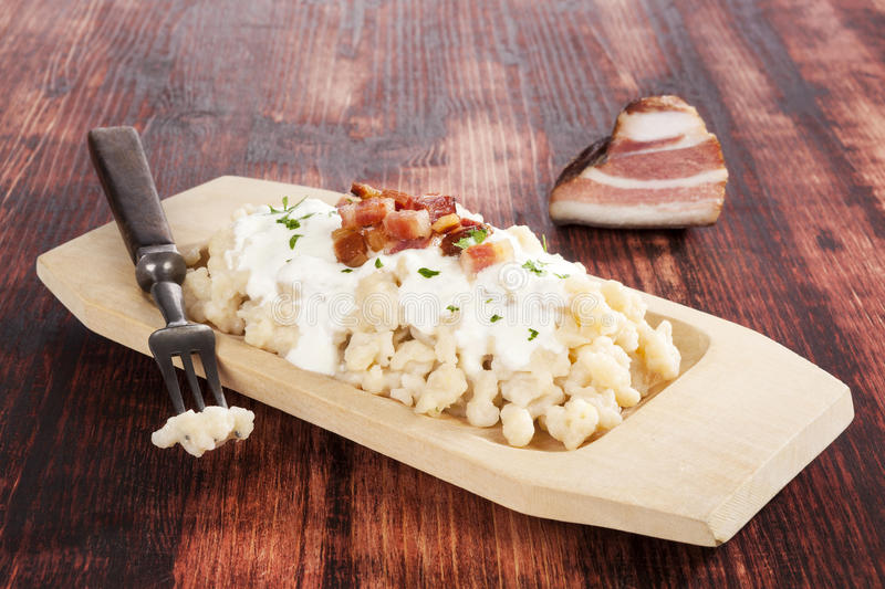 Bryndzove halusky. Potato dumplings with bryndza sheep cheese and bacon. Bryndzove halusky, traditional national slovak food stock images