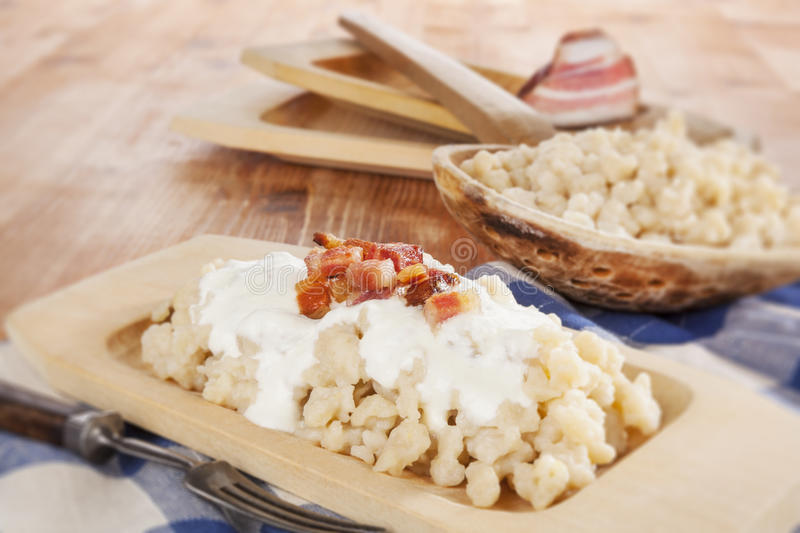 Bryndzove halusky. Potato dumplings with bryndza sheep cheese and bacon. Bryndzove halusky, traditional national slovak food royalty free stock photography
