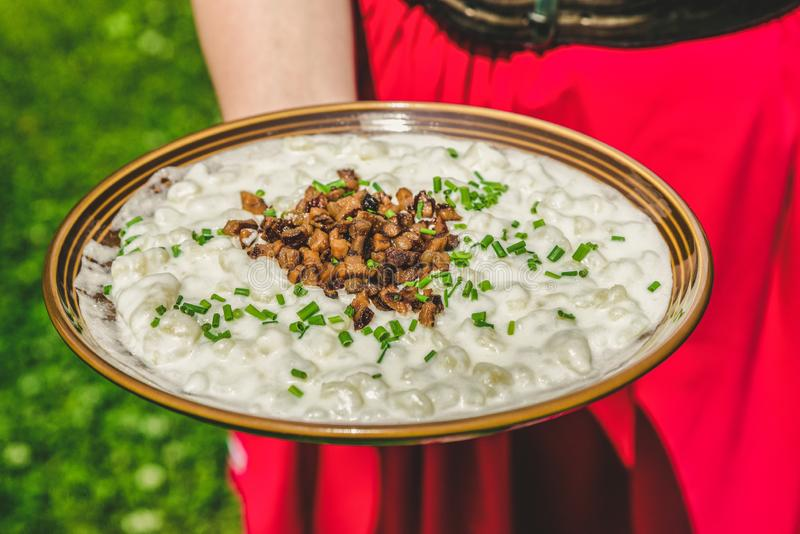 Bryndzove halusky - slovak national food. Slovak potato dumplings with sheep cheese called Bryndzove halusky - national food of Slovakia stock images