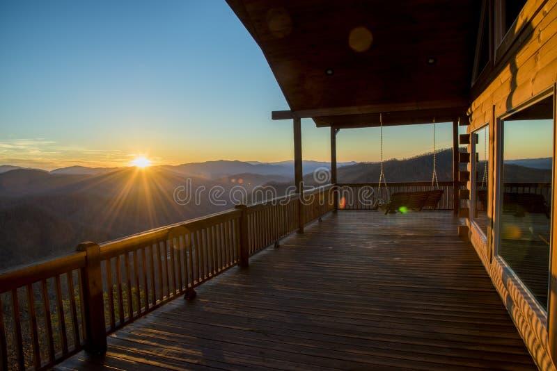 Bryson city cabin north carolina sky rocking chairs. Bryson city cabin north carolina sky rocking stock image