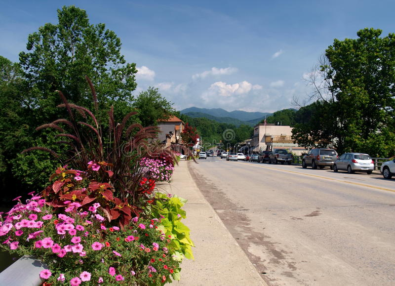 Bryson City, North Carolina. Colorful flowers line the bridge over the Tuckasegee River that flows through town. Bryson City is a popular tourist destination stock image