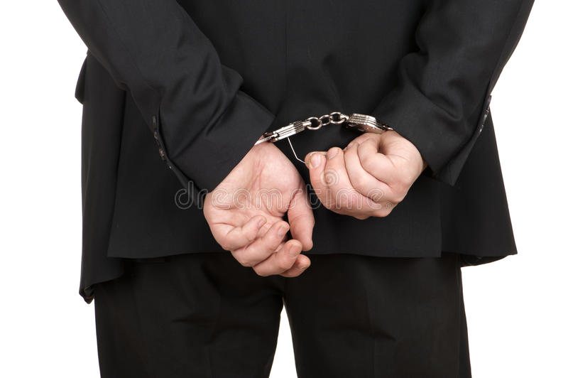 bryta affär handfängslar mannen royaltyfri foto