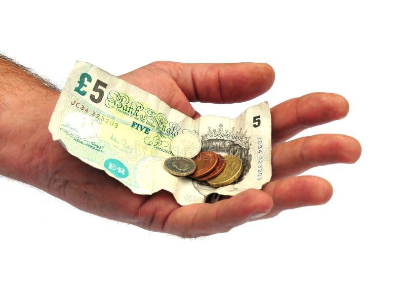 brytyjczycy ręka trzymająca waluty fotografia royalty free