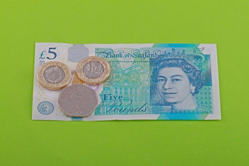 Brytyjski, UK żywa płaca siedem funtów i pięćdziesiąt pens, zdjęcie royalty free