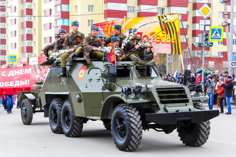 BTR-152. NOVYY URENGOY, RUSSIA - MAY 9, 2015: Soviet wheeled armored personnel carrier BTR-152 drives in the city street during the annual Victory Parade royalty free stock images