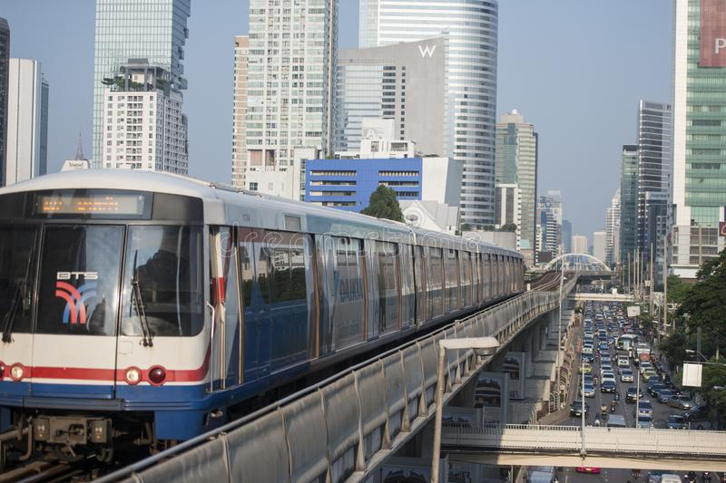 THAILAND BANGKOK SATHON SKY TRAIN. A bts skytrain over the trafic at the sathon road in the city centre at Sathon in the city of Bangkok in Thailand. Thailand royalty free stock image