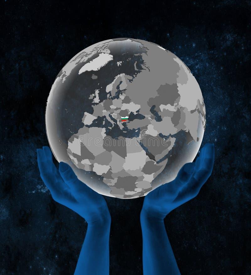 Bułgaria na kuli ziemskiej w rękach w przestrzeni royalty ilustracja