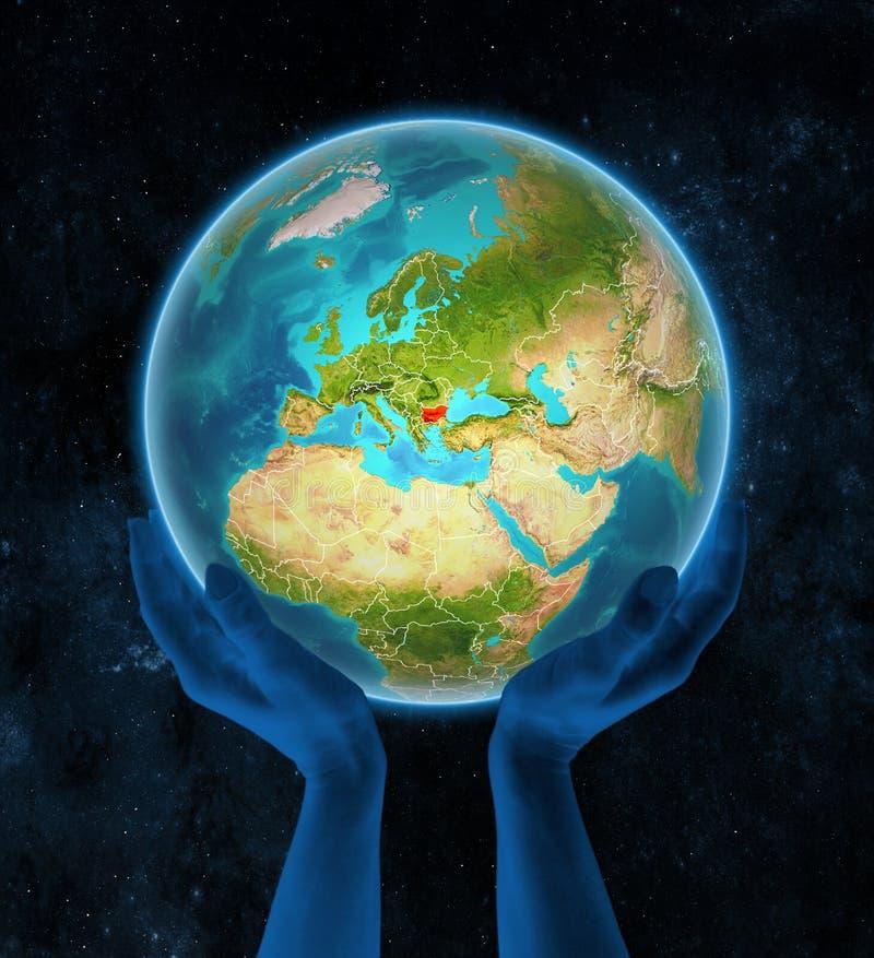 Bułgaria na ziemi w rękach w przestrzeni royalty ilustracja