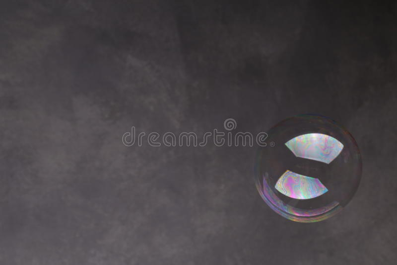 Bubble in the air. Close up. Gray background stock photo