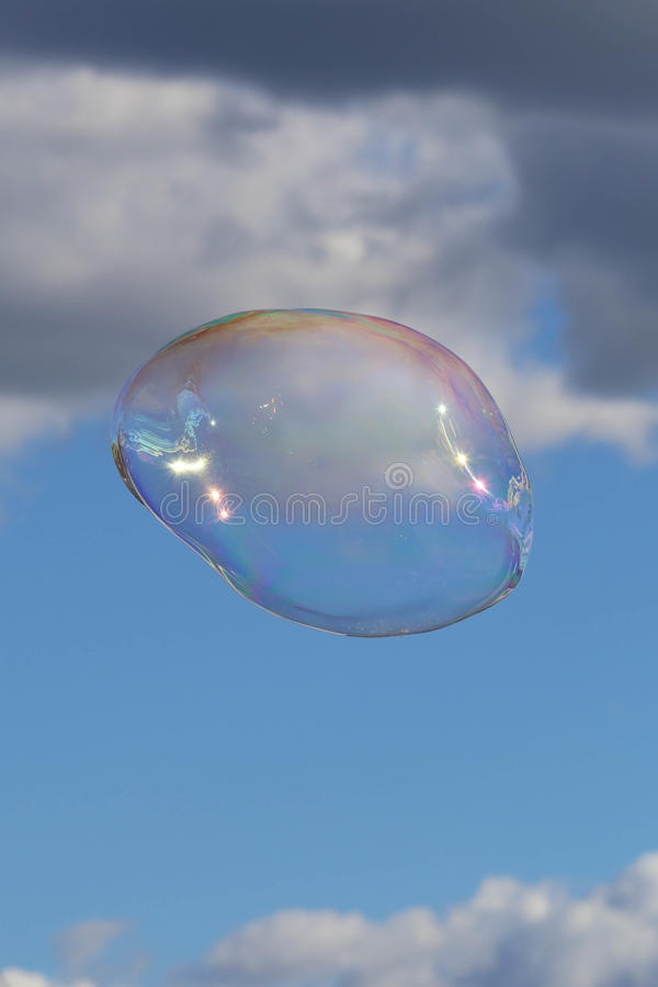 Bubble in the blue sky stock photography