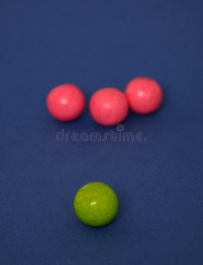 Bubble gum candies. Picture of a bubble gum candies with strawberry and apple taste. Blue background royalty free stock photo