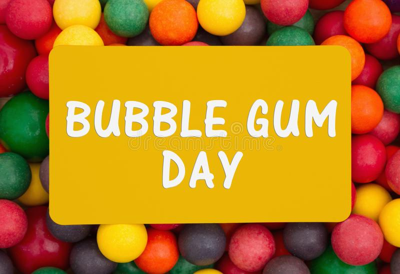 Bubble Gum Day message on a card. Bubble Gum Day message, Colorful multi colored bubble gum background with text Bubble Gum Day stock image