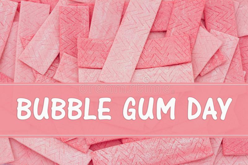 Bubble Gum Day message with gum sticks. A lot of pink chewing gum sticks with text Bubble Gum Day royalty free stock photography