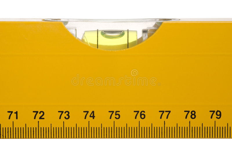 Bubble level. With a ruler on white royalty free stock photo