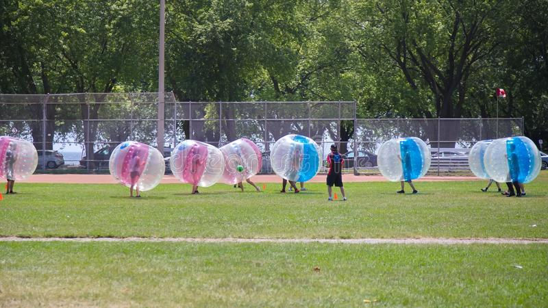Bubble Madness. Toronto, Ontario, Canada - July 16, 2016: Bubble Madness dressed participants are taking part in soccer match stock photo