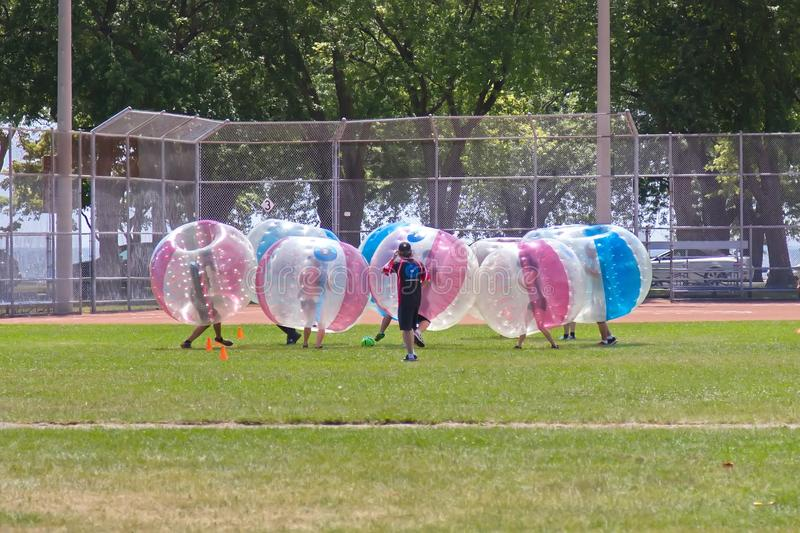 Bubble Madness. Toronto, Ontario, Canada - July 16, 2016: Bubble Madness dressed participants are taking part in soccer match stock images