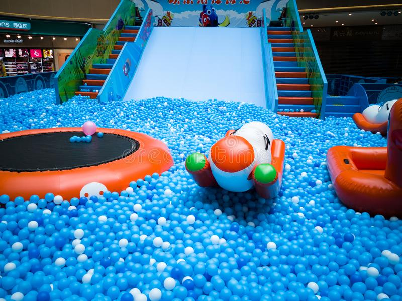 Bubble pool for kids with toys. Blue bubble pool for kids, child and children. play inside like swiming in the sea for fun. execise to improve the baby action. a royalty free stock images