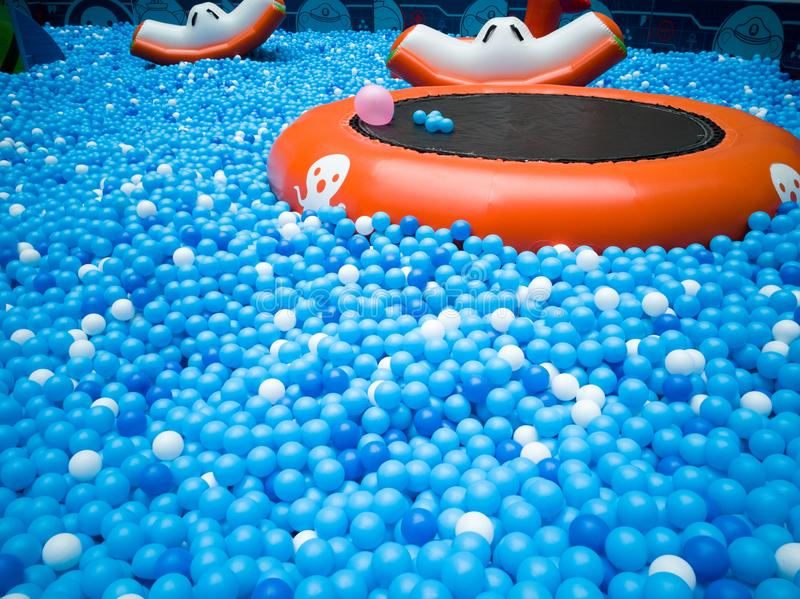 Bubble pool for kids with toys. Blue bubble pool for kids, child and children. play inside like swiming in the sea for fun. execise to improve the baby action. a royalty free stock photo
