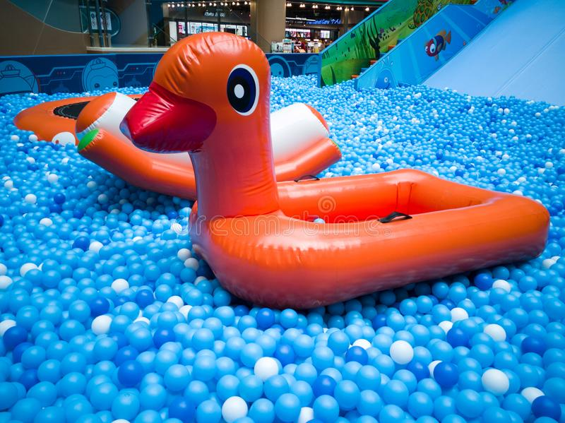 Bubble pool for kids with toys. Blue bubble pool for kids, child and children. play inside like swiming in the sea for fun. execise to improve the baby action. a royalty free stock photography