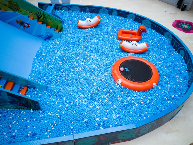 Bubble pool for kids with toys. Blue bubble pool for kids, child and children. play inside like swiming in the sea for fun. execise to improve the baby action. a stock photo