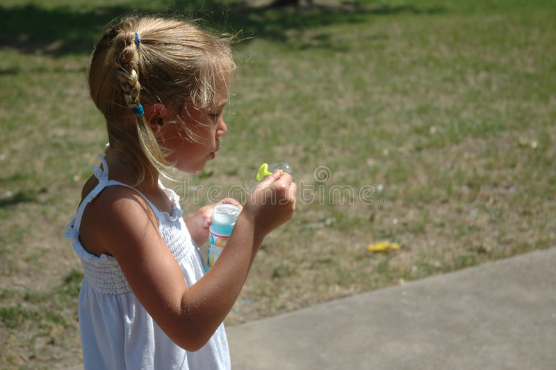Bubble time. Girl blows bubbles. Beautiful Young blonde model stock image