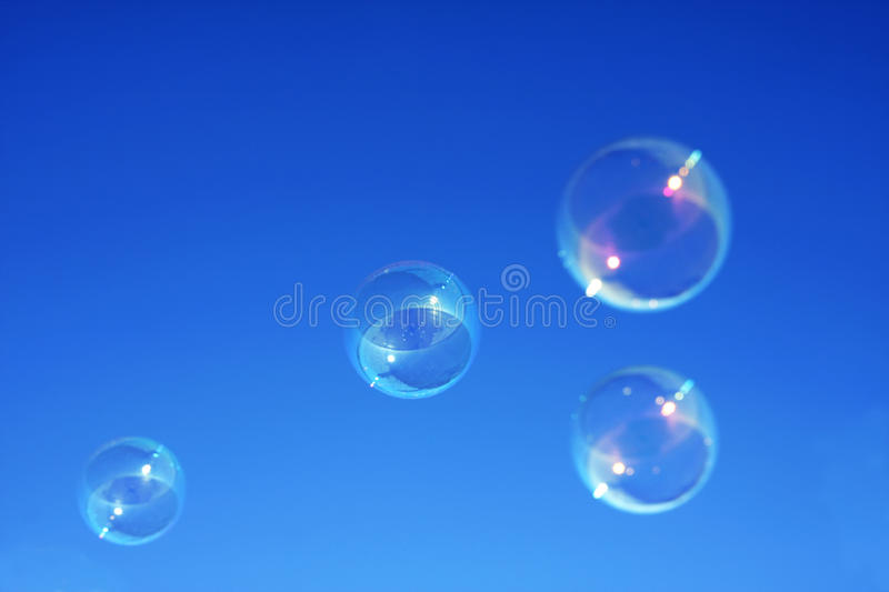 Download Bubbles against a blue sky stock photo. Image of float - 17575630