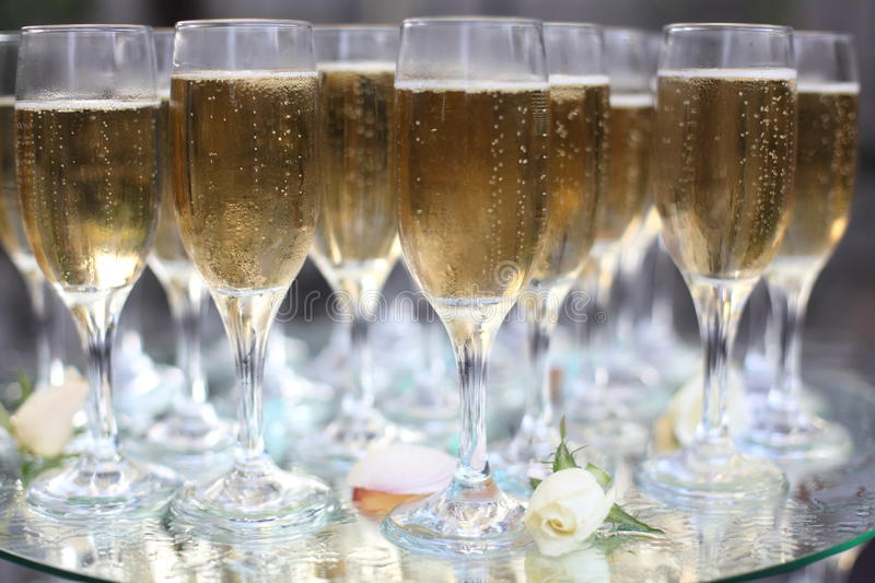 Bubbles in champagne. Champagne glasses with bubbles at a wedding or birthday party stock photography