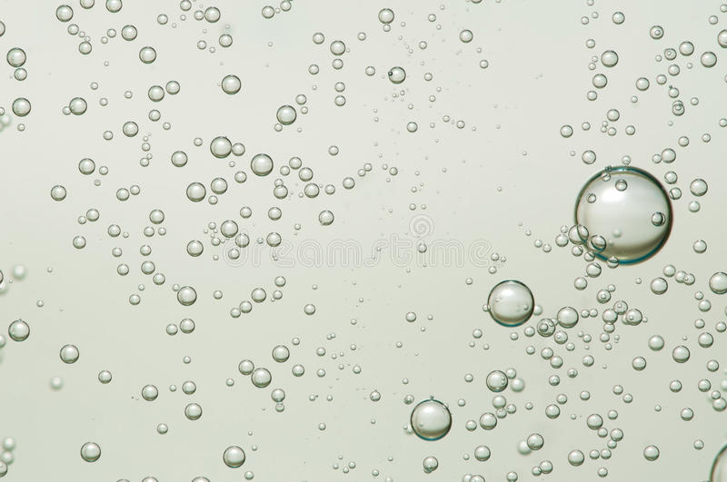 Bubbles. Champagne bubbles flowing over a light background stock images