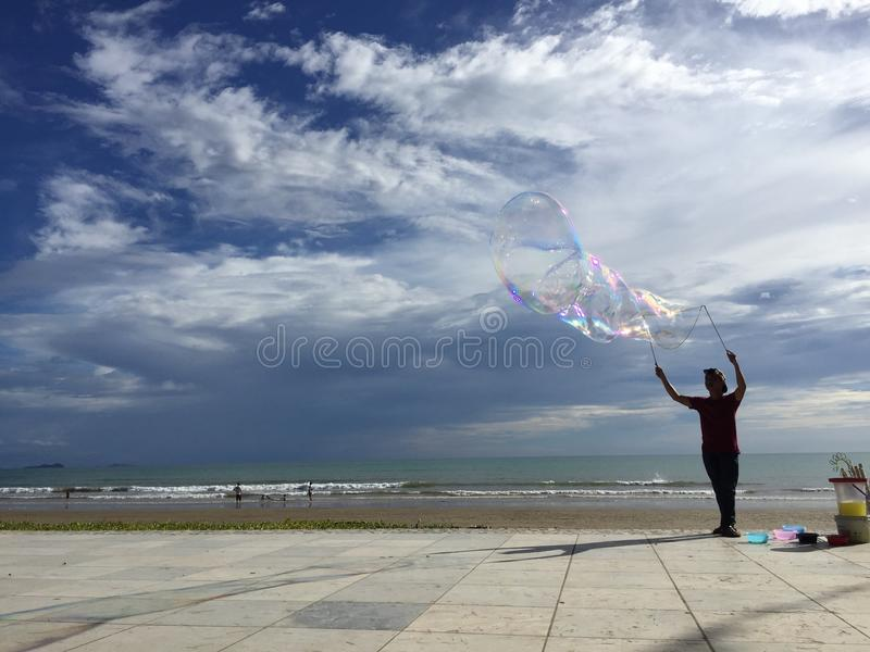 Bubbles with a clear blue sky at Tanjung Aru royalty free stock photography