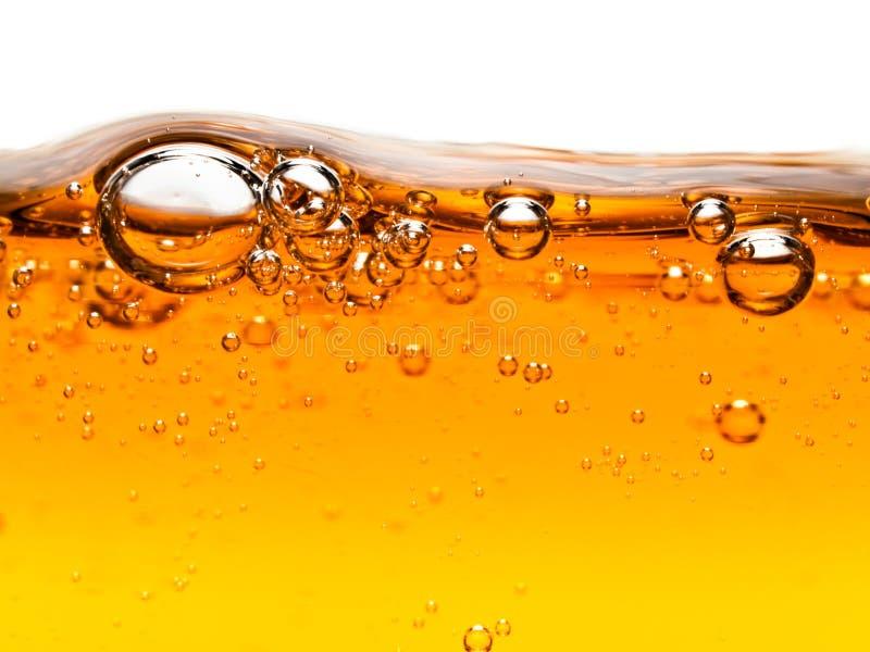 Bubbles in orange liquid soap royalty free stock photos