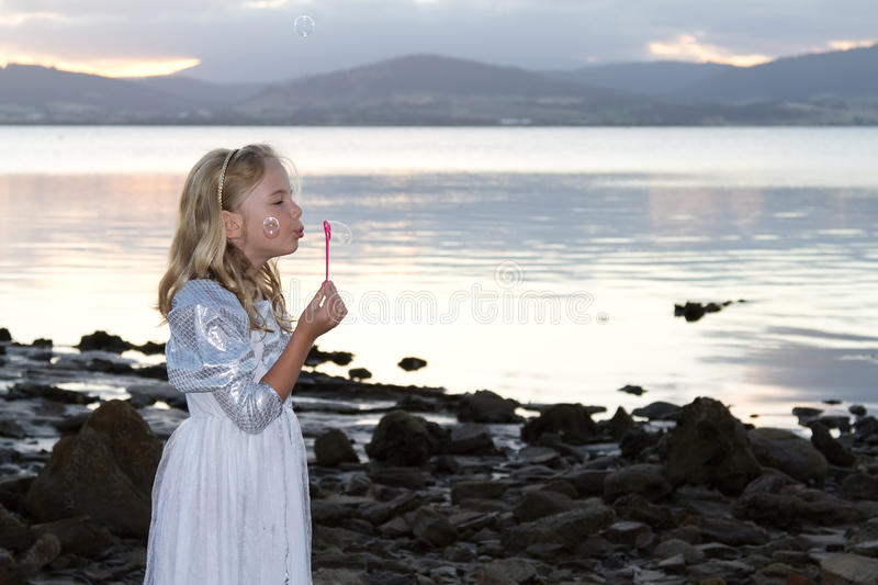 Bubbles by the sea shore royalty free stock photography