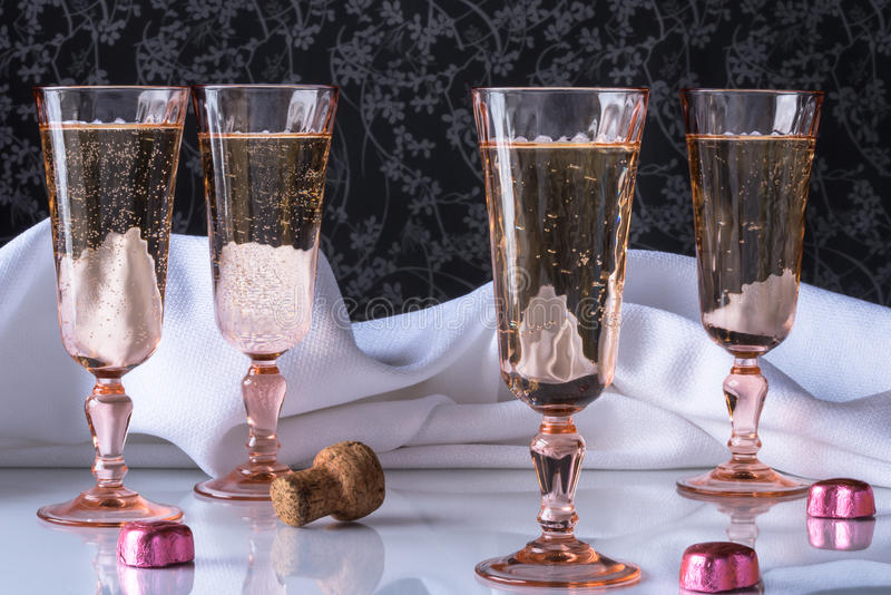 Bubbly in flutes. Bubbly in pink champagne flutes royalty free stock photography