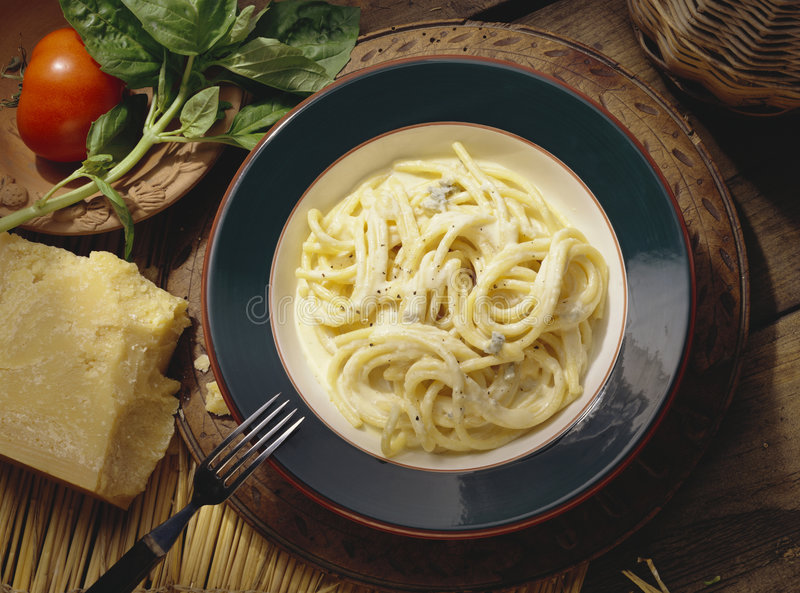 Bucatini. With sauce of four types of cheese royalty free stock image