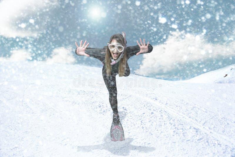 Buceador en una ventisca de la nieve fotografía de archivo