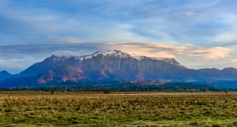 Bucegi mountains, Brasov, Romania: Landscape view in the sunset light of the snowy, Bucegi, Romania stock photography