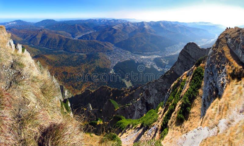 Bucegi mountains high altitude panorama, steep heels in autumn - Busteni city view. Bucegi mountains panorama, Romania, Transylvania, very steep cliffs stock photos